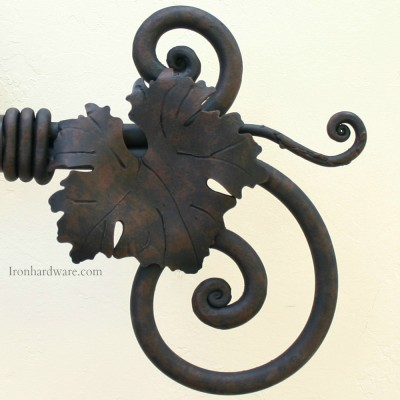 Hand Forged Wrought Iron Curvado Finial with Grape Leaf and Tendril shown in our exclusive iron oxide finish available only at Paso Robles Ironworks