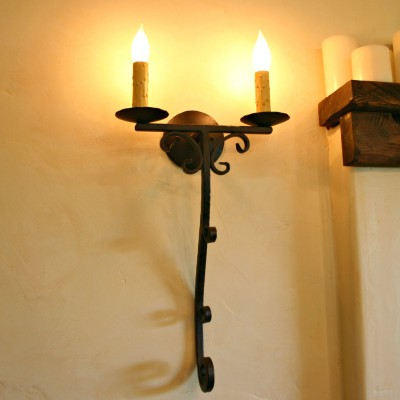 Hand Forged Wrought Iron Tuscan style light Sconce shown in our exclusive iron oxide finish available only at Paso Robles Ironworks